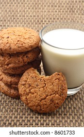 glass of milk and stack of chocolate chip cookies