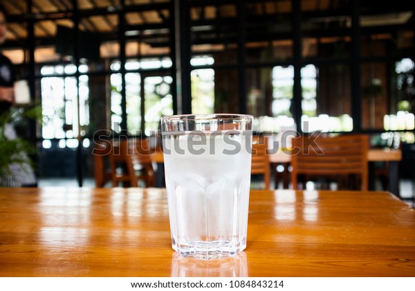 glass of mineral water on wood table in restaurant