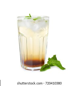 Glass with mint julep on white background