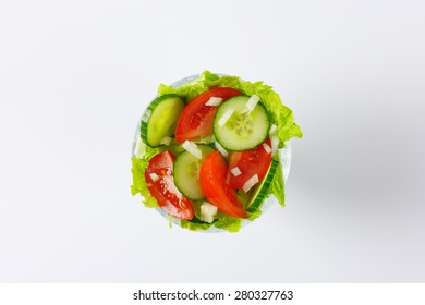 glass of mixed vegetable salad on white background