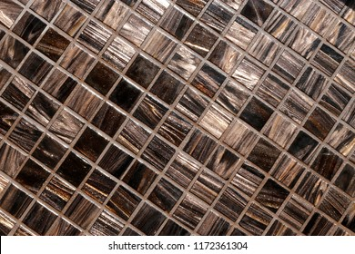Glass mosaics with pearl effect. Wall or table surface. Abstract architecture / interior background with checkered geometric structure. Luxurious finishing material with natural irregular texture.