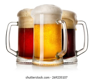 Glass mugs of beer isolated on a white background