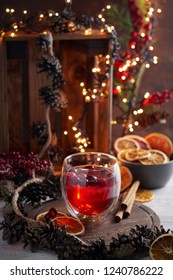 Glass of mulled wine with cranberry. Christmas or New Year Winter drink on bokeh background. Close up view, selective focus