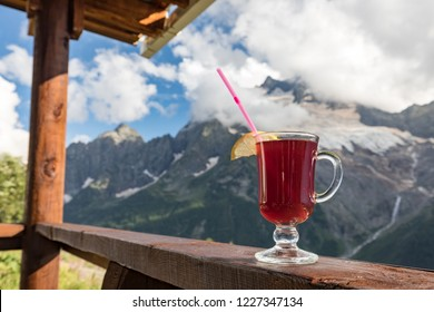 Glass of mulled wine on the background of Dombay mountains