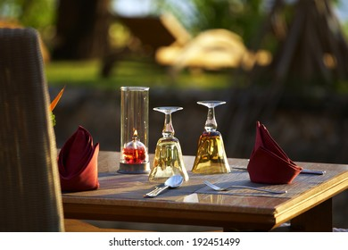 glass and napkin on wooden table