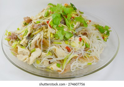 glass noodle pork spicy salad on plate