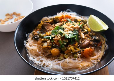 glass noodles with shiitake vegetable sauce. vegetarian asian meal.