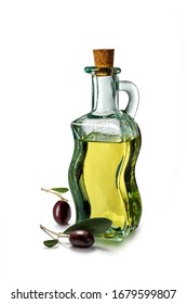Glass oil cruet and olives isolated on white background