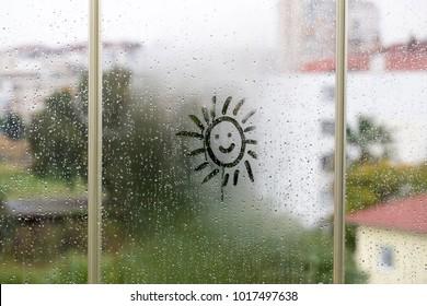 The glass on the rain drop drawing sun