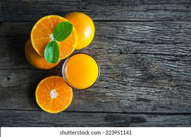 Glass of orange juice from above on wood table. Empty ready for your orange juice, fruit product display or montage.