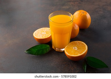 Glass of orange juice from above on vintage stone background. Selective focus with copy space. Healthy Eating concept