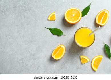 Glass of orange juice and fresh fruits on table, top view