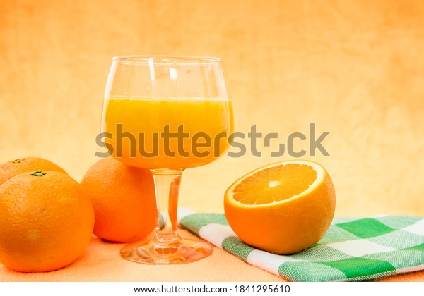 glass-orange-juice-oranges-on-600w-18412