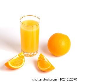 Glass of orange juice and slices of orange fruit isolated on white background.