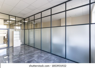Glass partition. Glass wall in the office space.