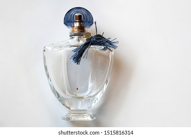 Glass perfume bottle with cobalt fringe isolated on white background from a high angle view
