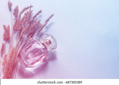 A glass perfume bottle, a female fragrance, an accessory for beauty