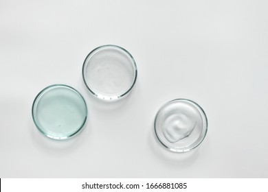 Glass petri dish with different cosmetic products on white background. Shampoo, hair conditioner or mask and shower gel, top view - Shutterstock ID 1666881085