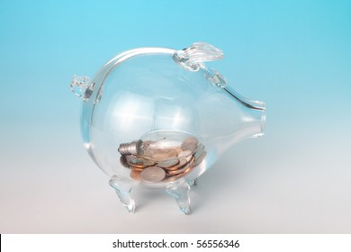 Glass piggy bank with an old light bulb in his belly