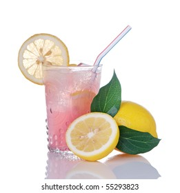 Glass of pink lemonade and lemons with leaves