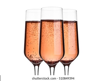 Glass of pink rose champagne with bubbles on white background