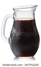 Glass pitcher of cold kvass, isolated