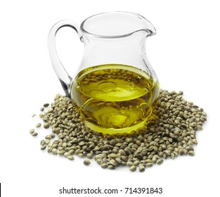 Glass pitcher with hemp oil isolated on white