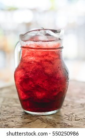 Glass pitcher with herbal juice,some blurred focusing : Roselle juice.