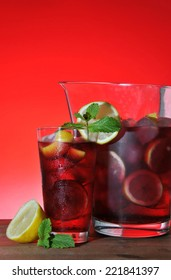 glass and pitcher of ice cold Sangria