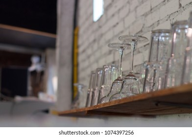 Glass placed on wooden floor White wall In the coffee shop