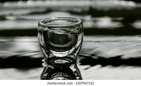 Glass of plain water / Water is a transparent, tasteless, odorless, and nearly colorless chemical substance