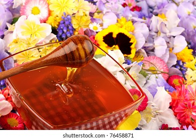 Glass pot with honey with many flowers