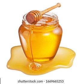 Glass pot of honey and sweet sticky honey puddle isolated on white background.