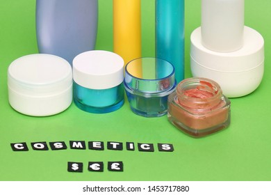 Glass pots and plastic containers of expensive creams and other cosmetics