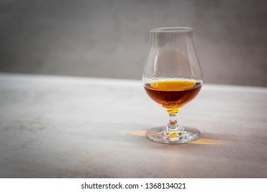 Glass of premium alcoholic drink (rum, cognac, whiskey)
