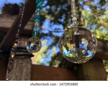 Glass prisms hanging in the sun