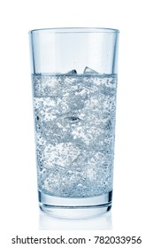 Glass with pure sparkling soda and ice on white background