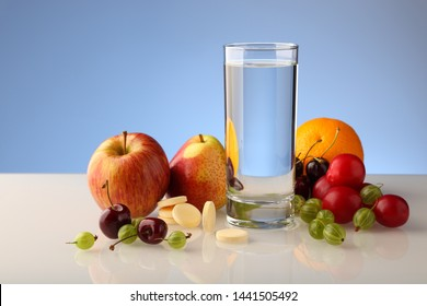 A glass of pure water with fruit and effervescent soluble vitamins in tablets.