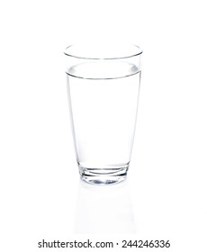 Glass of purity water on white background