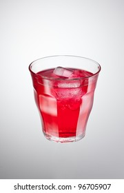 glass of red cranberry carbonated drink