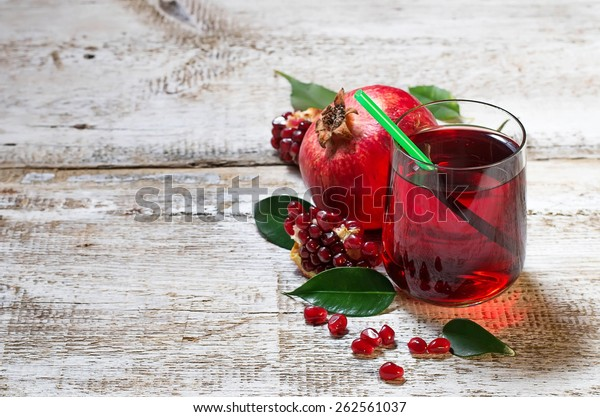 Glass of red pomegranate juice. Selective focus. Copy space background
