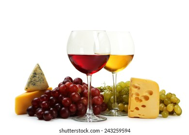 Glass of red and white wine, cheeses and grapes isolated on white