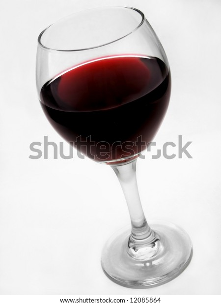 A glass of red wine against a white background.