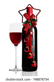 Glass of red wine with bottle and christmas theme decoration on white background