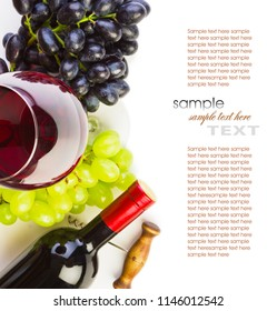 glass of red wine with bottle and grapes on a white background