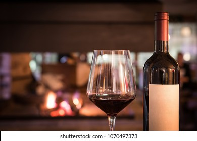 Glass red wine and bottle in restaurant interior wit copy space