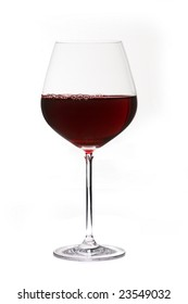 Glass of red wine with bubbles on white background