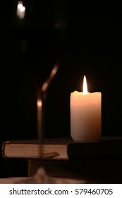 glass of red wine and candle