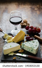 Glass red wine with cheese board and back light.