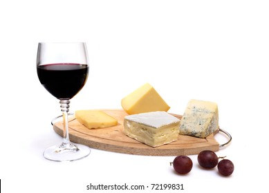 Glass of red wine and cheese isolated on white